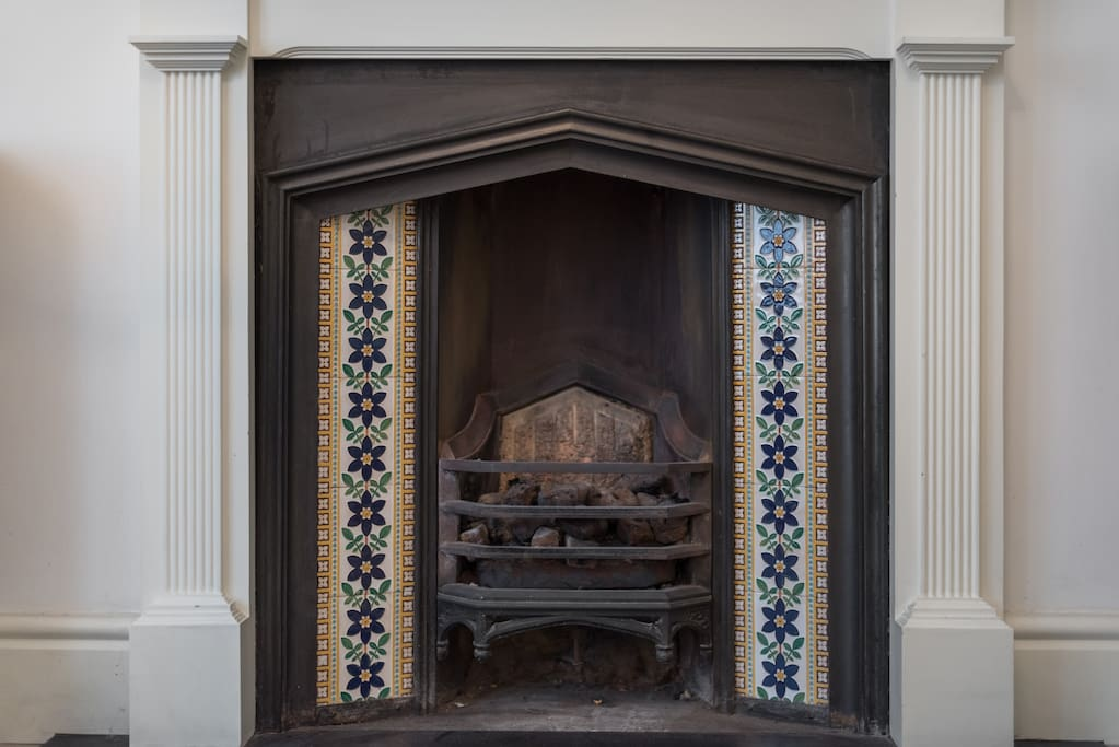 Original Victorian features populate the flat, including these classic antique fireplace tiles