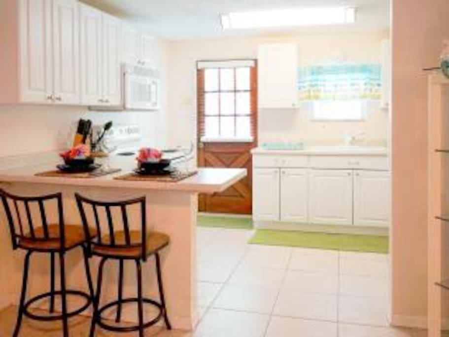 Eat in kitchen with breakfast bar. Your pool is right outside the door