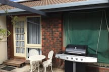 Private entrance and BBQ area