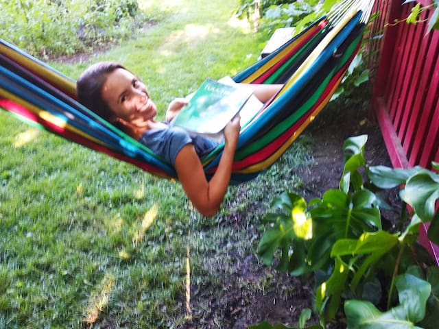 A Brazilian student who stayed with us in June and July, enjoying the hammock to do some English studying for school.
