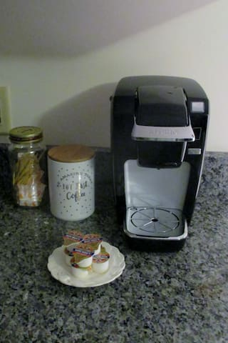 You have coffee, creamers, sugar, teas sugar to get you through your first morning.  Use bottled water for best taste.  Replace what you use if you are staying more than an overnight. Drip coffee maker in the cabinet, some filters, BYO ground coffee.