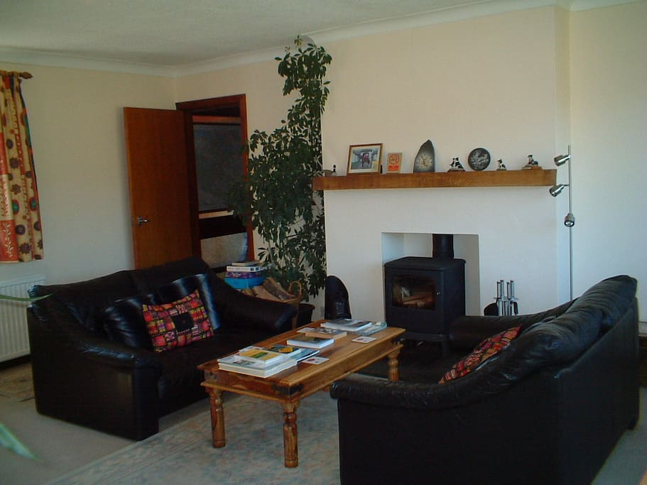 Guests lounge  with cosy log burner for the cooler months