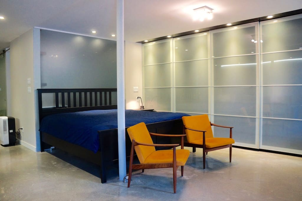 King size bed: cozy and comfortable (also showing vast integrated closet space with sliding doors)