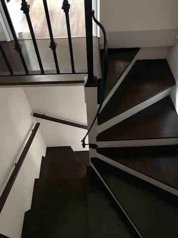 Spiral stairs to upstairs bedroom