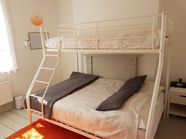 Bedroom  2 - with a double bed and upper single bunk bed. Bright & airy with window overlooking garden