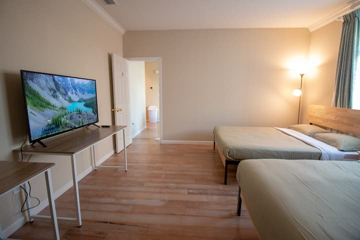 Room 26 with two Queen size bed with 4k 50'' T