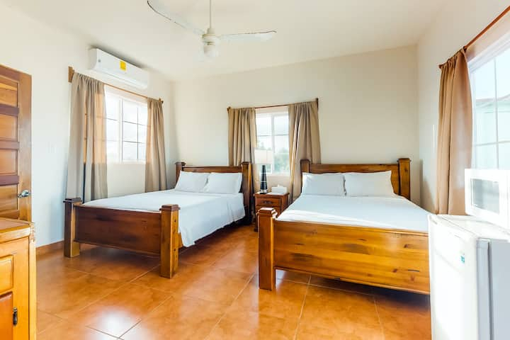 Cozy studio near town with an ocean view, free WiFi, partial AC & shared deck!