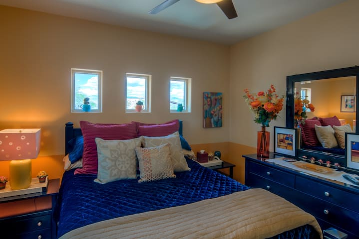 The Prickly Pear Bedroom has a Vintage Florence, Italian Hand-Crafted Queen Bedroom Set. Cactus Decor with Whimsical Motifs.  Mountain Views from the Pocket Windows
