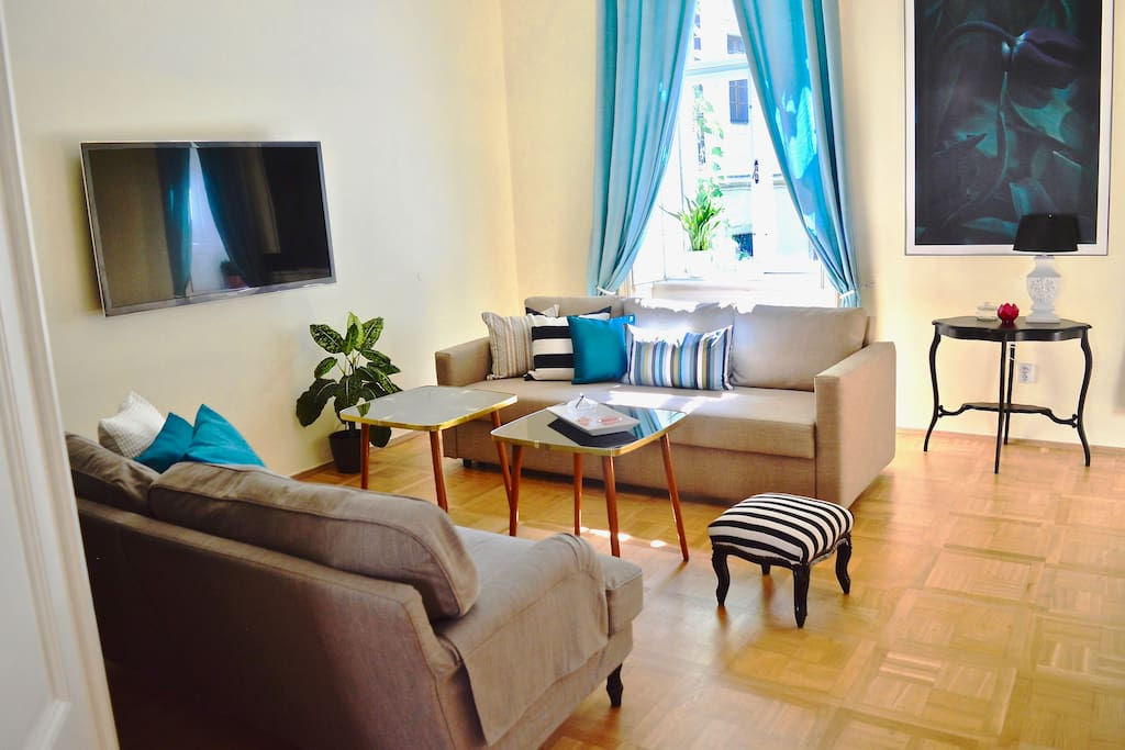 Spacious lounge area with two sofas with flat screen TV WIFI