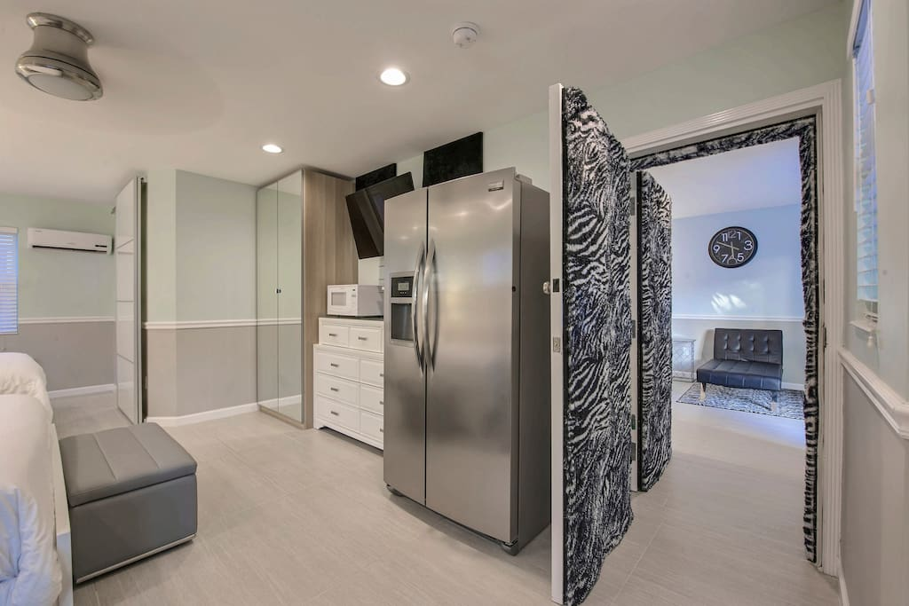A Frigidaire refrigerator with ice maker, Keurig machine, microwave and sink can be found in the kitchenette