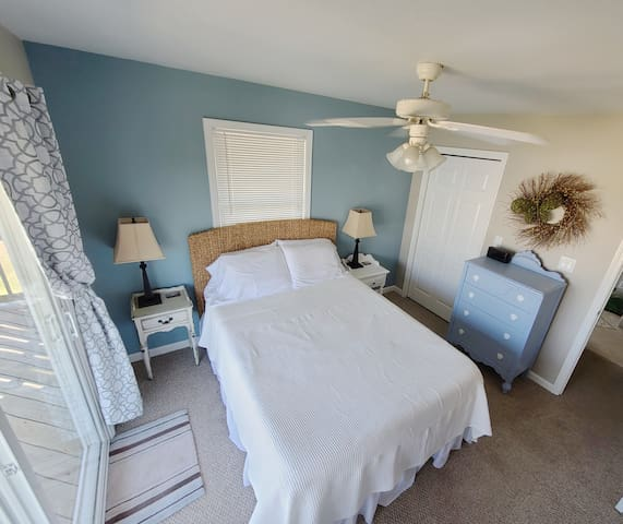 Master bedroom with attached deck