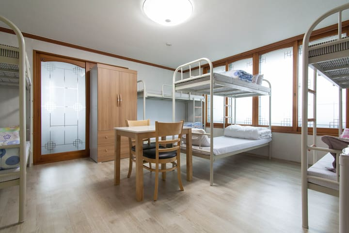 Bed in 8-bed female dorm 1