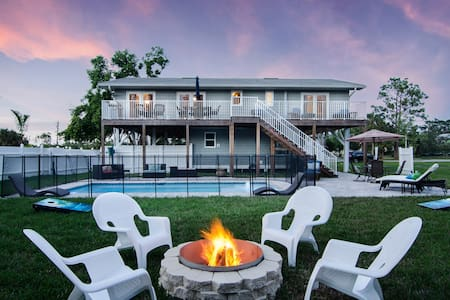 Pamper yourself at this Key West style pool home!