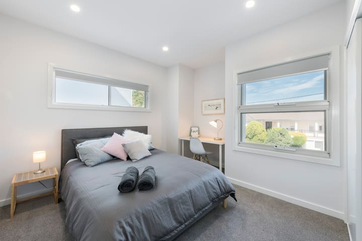 Second bedroom upstairs is light and airy. With built in wardrobe and desk, you will feel right at home.