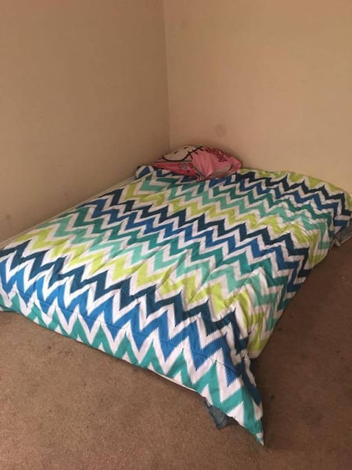 Large Bedroom King Size Mattress. Room for you to bring in an air mattress too.
