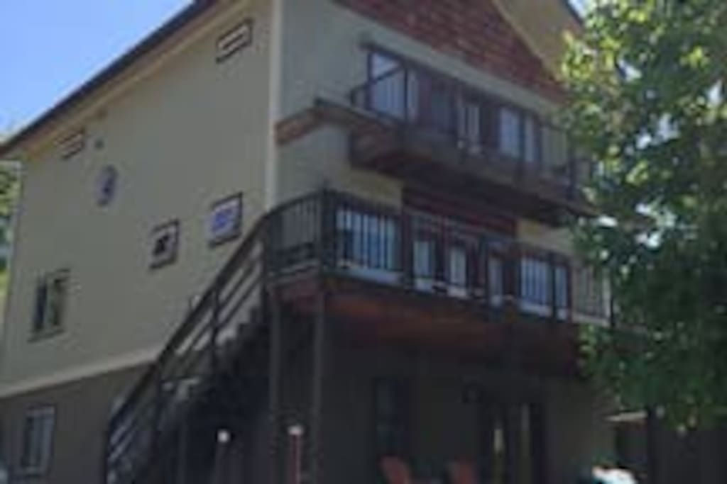 Cozy apt is on ground floor. I live in the upper two floors. The apt has a comfortable deck from which you can see some of Somers Bay and is bordered by berry bushes.