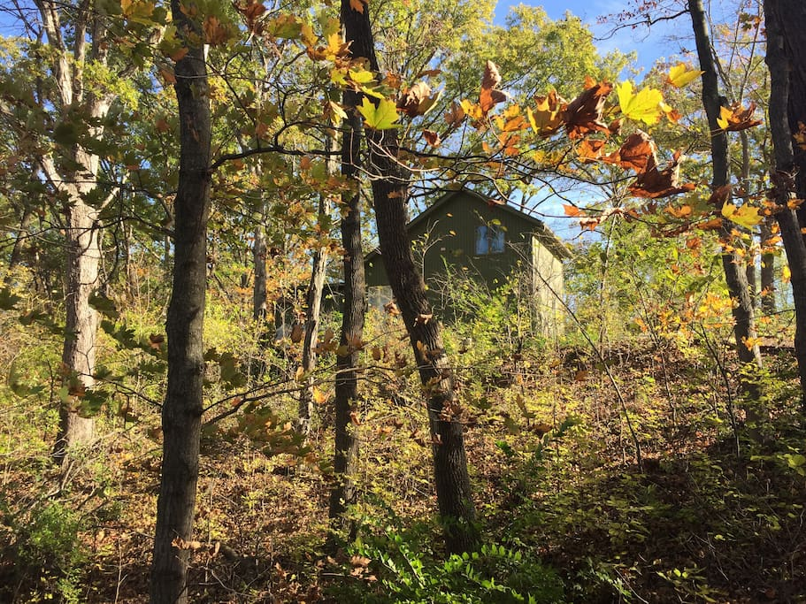 The cottage stands on a 75 foot cliff overlooking a beautiful view, especially in the fall!