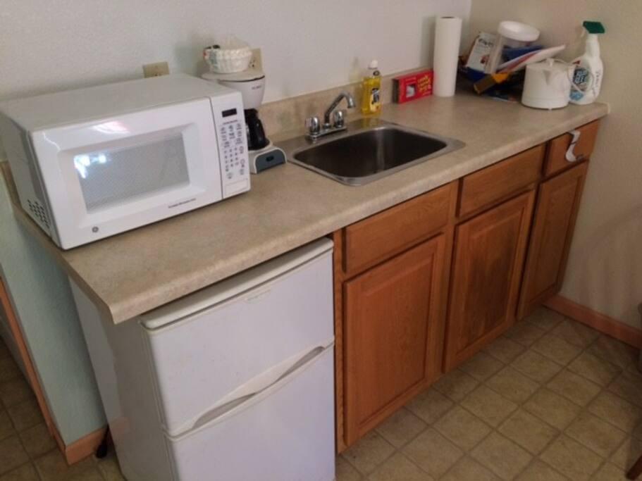 Kitchenette counter w/ sink, M/W, refrigerator w/ separate freezer