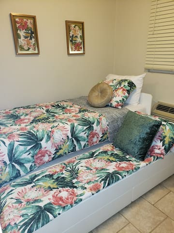 Third bedroom with trundle style twin beds.