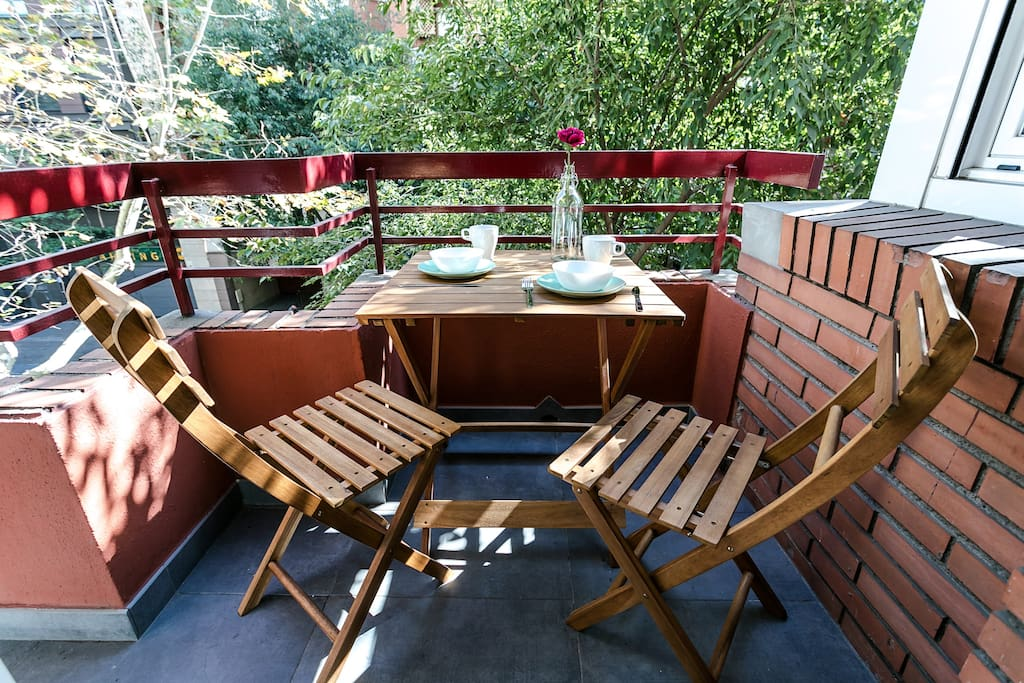 Cosy balcony with table for 2