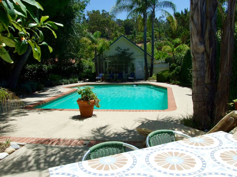 Swim all year in the 40' heated pool with spa. Looking from Master Suite wing to guesthouse.