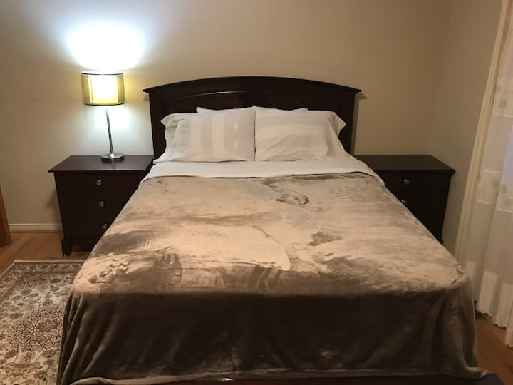 Private furnished bedroom in a detached house