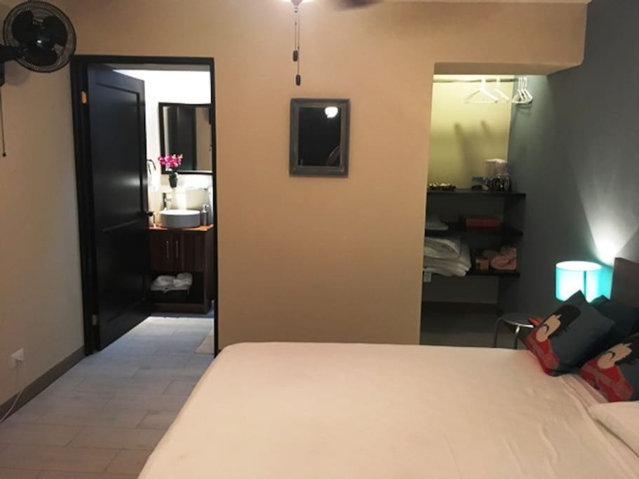 Interior of # 5 showing Queen bed and entrance to private bathroom
