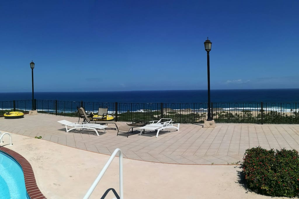 Panoramic sun deck by the pool overlooking the ocean