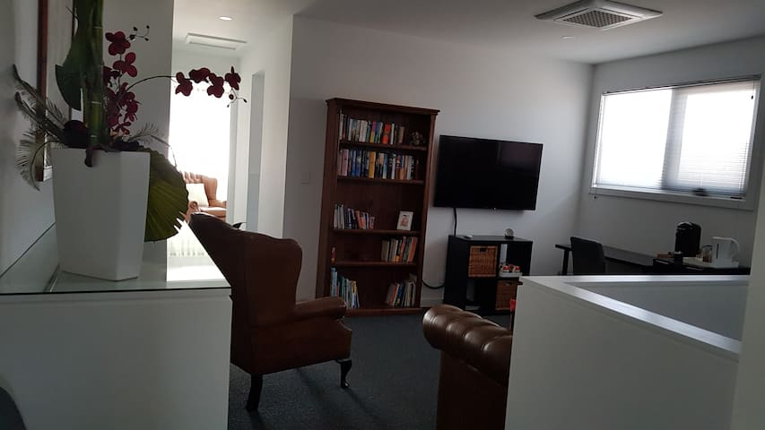 Living room. Central to the accommodation. Reverse cycle airconditioning. T.V. Neflix, wifi, coffee and tea facilities.