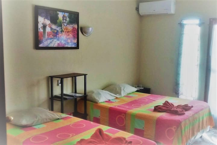 Lakeview Room Top Level, brand new very powerful LG Air Condition Unit, Private Bath with Hot Shower, Westside Balcony with Table and Chairs to dine outside. See the Sun set with a chilled bottle of good Chilenean Wine!