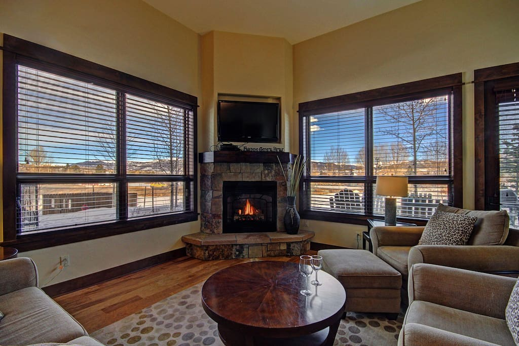 Living room with large windows - Enjoy the gorgeous views from the living area.