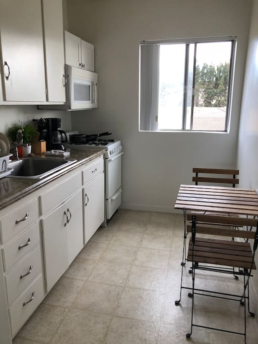 Full kitchen with fridge and microwave and granite countertops