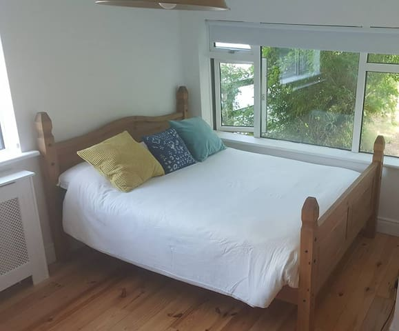 Large king bed in large bedroom - there is space for 2 floor mattresses if required