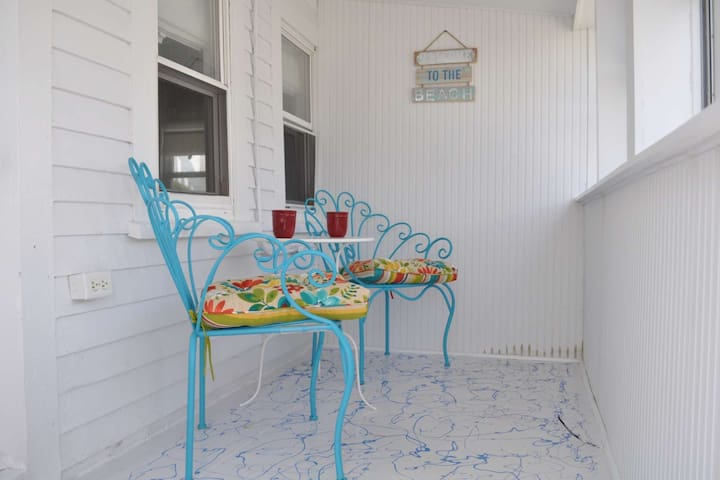 Relaxing in the morning as you sip coffee on the sun porch - planning to explore Salisbury Beach and beyond