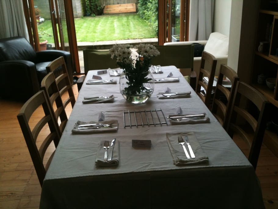 Spacious open plan kitchen and dining room with bifold doors out to garden