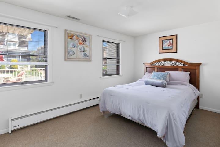 Room 1: Queen bed (bathroom is next door in hallway)