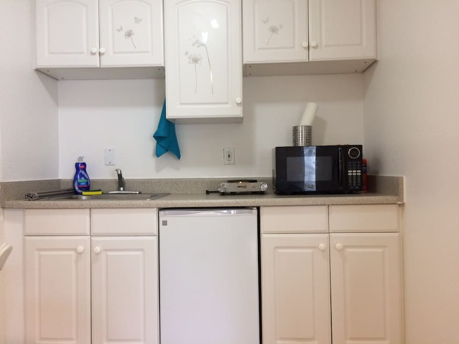 Kitchenette--hot plate, microwave, small fridge, all utensils, pots/pans, and other cooking items