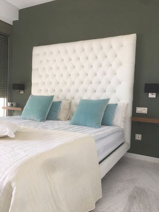 The master bedroom boasts a king size bed and leads to the terrace