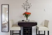 living space includes folding high top dining table (seats 4) with champaign and wine available by the bottle or glass