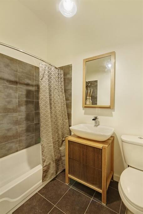 Clean bathroom with shower  and bathtub