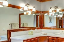 The master bathroom provides large mirrors and plenty of counter space.