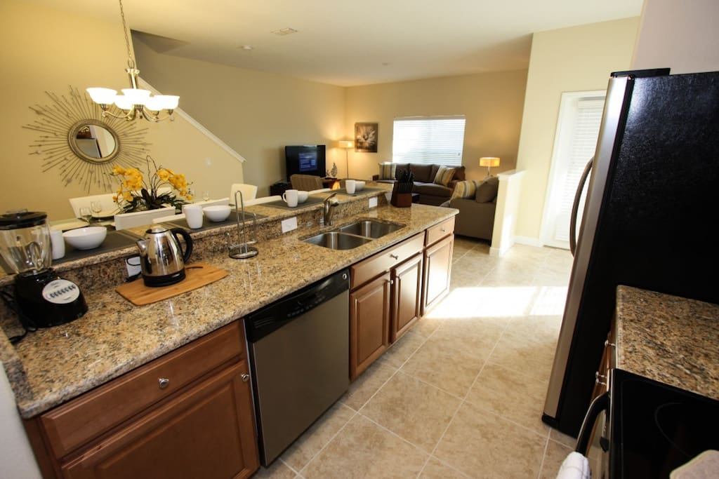 Modern Kitchen w/Stainless Steel Appliances and Granite Counter Tops