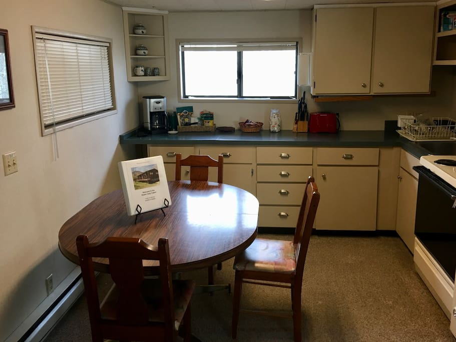 Fully stocked kitchen and full size dining table