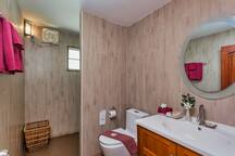 Bathroom with shower and toiletries