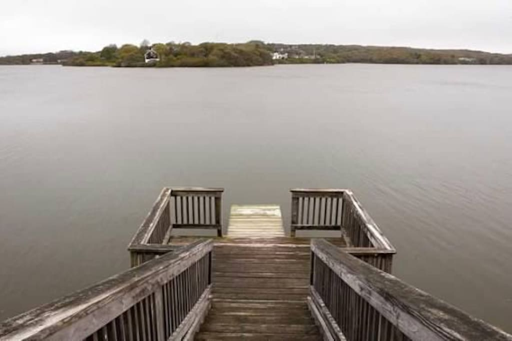 This dock leads to a beautiful fresh water pond .