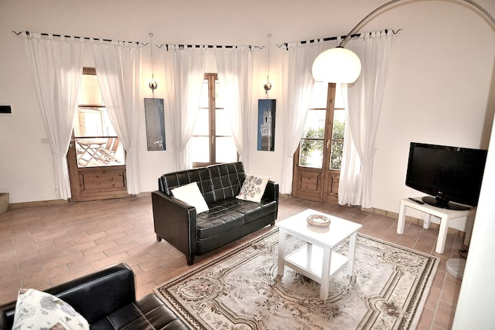 The Living area of your apartment which is a very large open space with the kitchen and with the mezzanine floor above the kitchen itself.