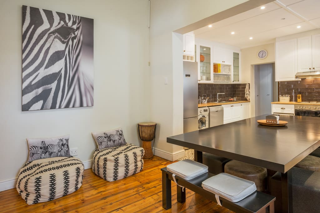 """""""I LOVE the table and living space. It allows comfort and sense of family as evening discussions take place. I love the poof chairs, guitar, drum -- all good touches that help create a nice group space. The bedding was so comfortable!!""""  -Tiffany G. (Zebra Crossing Group, Chicago, IL, USA)"""