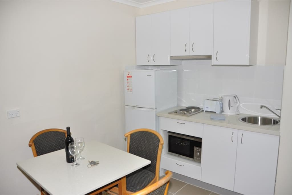 Fully equipped kitchen with 4 seater dining suite