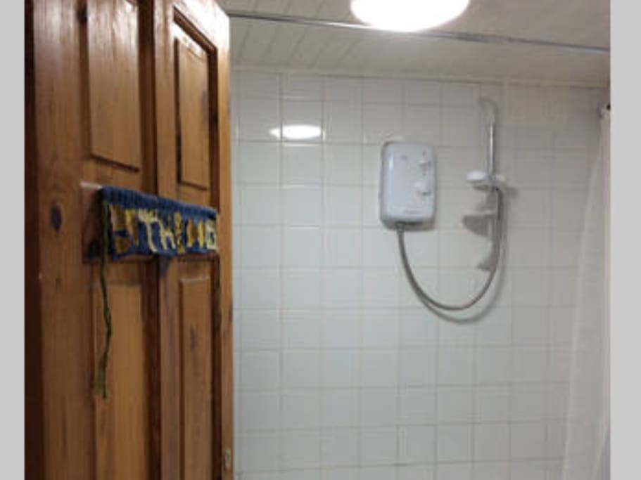 Shared bathroom with shower facility.