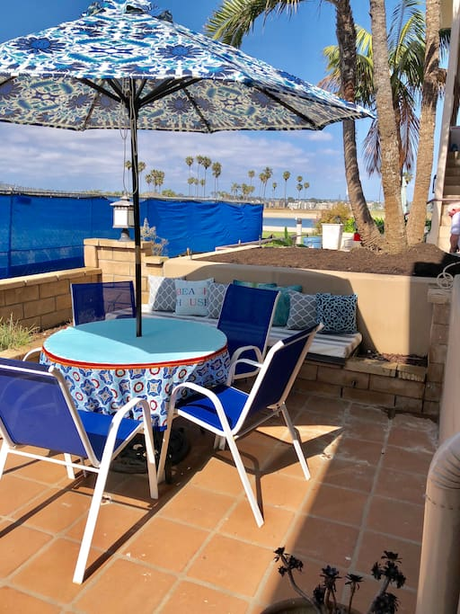 Patio steps from beach with Gas Grill, seating for 5 plus bench, & views to the bay!